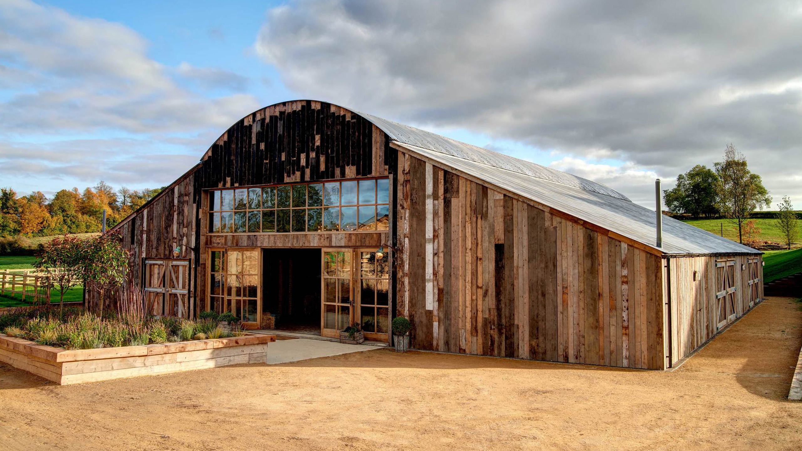 A similar sized barn restored with reclaimed materials!